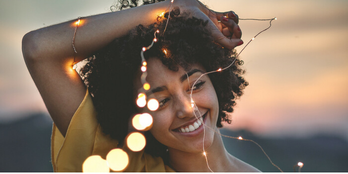 Rediscover the Real You-Happy Woman Holding Delicate Fairy Lights