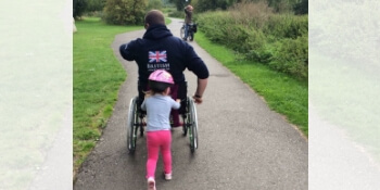 Would I Change Things? Little Girl Pushing Daddy in WheelChair